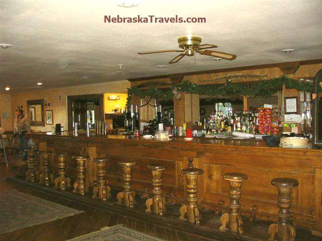 Uncle Bucks Lodge Wooden Barstools in Western Nebraska Sandhills near Brewster